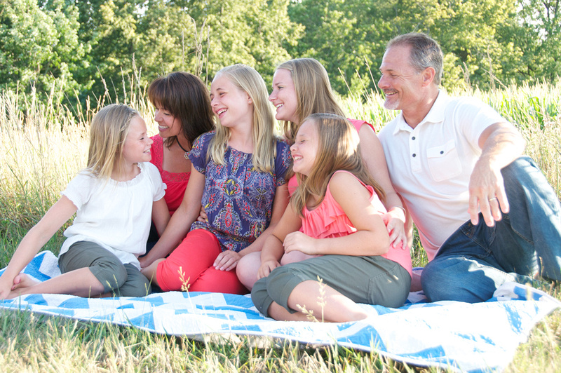 Family portrait session picnic in fields of Indiana