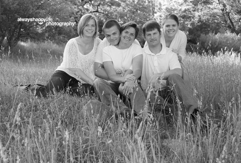 Fun family portrait in field